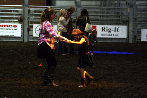 A pair of cowgirls stomp up a storm at the Dance in the Dirt event at the Black Gold Rodeo